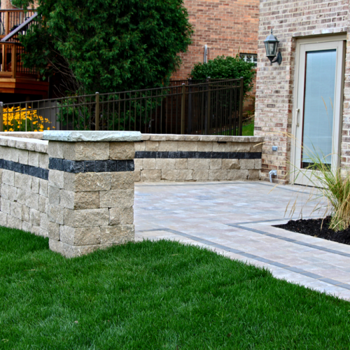 A picture of a beautiful brick paver and retaining wall