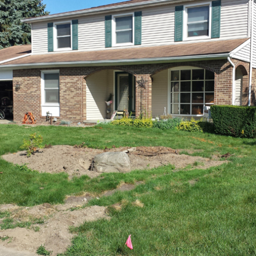 A before picture of outdated landscaping